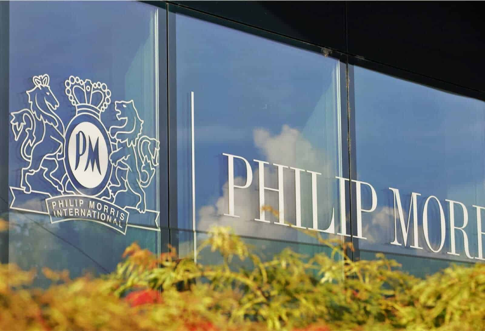 Phillip Morris International, PMI logo on glass window of building