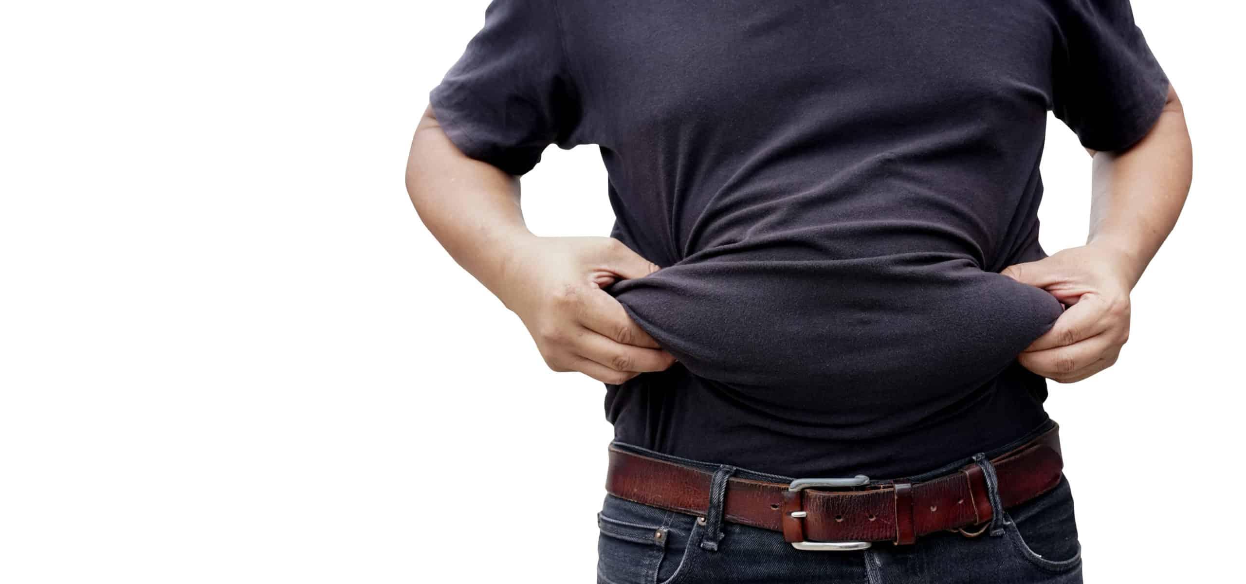 Overweight man in black t shirt grabbing belly fat